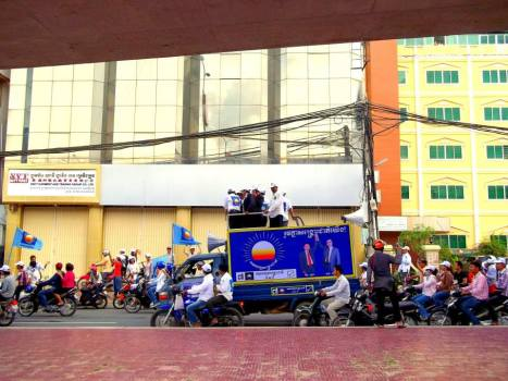 CNRP leaders ride a truck during a campaign rally